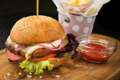 Grilled hamburger with beef and cheese. On wood board in the fast food restaurant Stock Photo