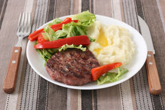Grilled hamburger with mashed potato Royalty Free Stock Photography