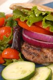 Grilled hamburger in a pita royalty free stock photography