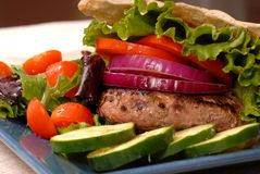 A grilled hamburger in a pita Stock Photo