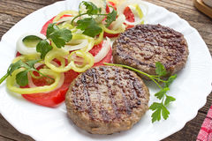 Grilled hamburger in plate Royalty Free Stock Photo