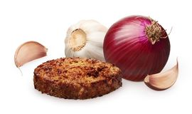 Grilled hamburger, red onion and garlic with cloves on white Stock Image