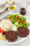 Grilled hamburger with rice Stock Image