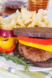 Grilled Hamburger on Toasted Pumpernickel Bread Royalty Free Stock Image