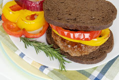 Grilled Hamburger on Toasted Pumpernickel Bread Stock Photo