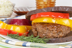 Grilled Hamburger on Toasted Pumpernickel Bread Royalty Free Stock Images