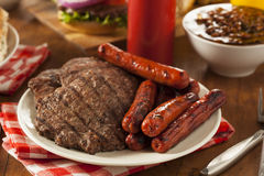 Grilled Hamburgers and Hot Dogs Stock Image