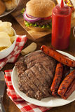 Grilled Hamburgers and Hot Dogs Royalty Free Stock Images