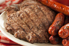 Grilled Hamburgers and Hot Dogs Stock Photography