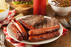 Grilled Hamburgers and Hot Dogs Stock Images