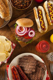 Grilled Hamburgers and Hot Dogs Stock Photo