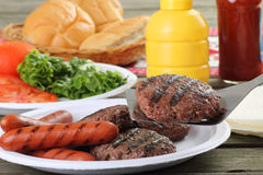 Grilled Hamburgers and Hotdogs Stock Images