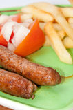 Grilled homemade sausages served with tomato salad Royalty Free Stock Photography