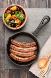 Grilled homemade sausages and vegetable salad Royalty Free Stock Photo