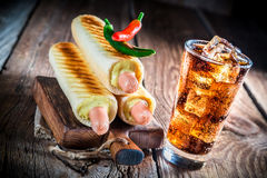 Grilled hot dog with cold drink Stock Photography