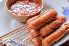 Grilled hot dog Stock Images