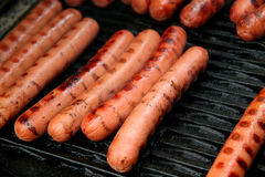 Grilled hot dogs on a grill Royalty Free Stock Photo
