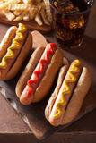 Grilled hot dogs with mustard ketchup and french fries Stock Image