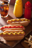 Grilled hot dogs with mustard ketchup and french fries Stock Photo
