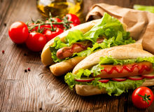Grilled hot dogs on a picnic wooden table Royalty Free Stock Image