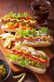 Grilled hot dogs with vegetables ketchup mustard.  Stock Photo