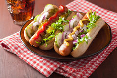 Grilled hot dogs with vegetables ketchup mustard Stock Photos