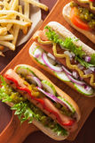 Grilled hot dogs with vegetables ketchup mustard Stock Photo