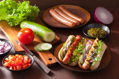 Grilled hot dogs with vegetables ketchup mustard Stock Image