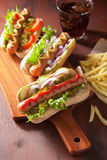 Grilled hot dogs with vegetables ketchup mustard Royalty Free Stock Images