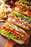 Grilled hot dogs with vegetables ketchup mustard Royalty Free Stock Photos