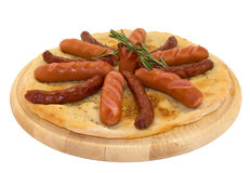 Grilled hot sausages and frankfurters on the pita. Bread on a white background Royalty Free Stock Photo