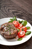 Grilled hot steak meat on plate Stock Photos