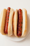 Grilled hotdogs. On white bread buns. This is a classic lunch meal Royalty Free Stock Images