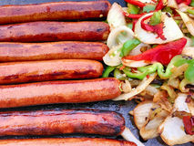 Grilled hotdogs and vegetables Stock Photo