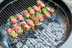 Grilled jalapeno pepper snacks on the charcoal stock photography