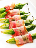 Grilled jalapenos wrapped in bacon Stock Photos