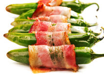 Grilled jalapenos wrapped in bacon Stock Photo
