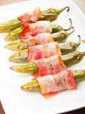 Grilled jalapenos wrapped in bacon Royalty Free Stock Images