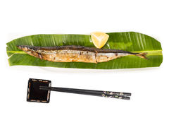 Grilled Japanese Sanma Fish served with lemon and soy sauce Stock Photography