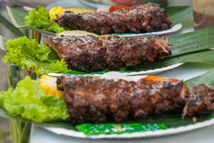 Grilled juicy barbecue pork ribs in a white plate Royalty Free Stock Photography