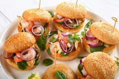 Grilled juicy burgers with seafood, close-up stock images