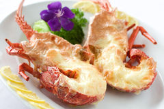 Grilled jumbo prawn with flower royalty free stock photos
