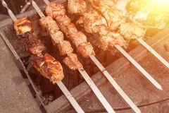 Grilled kebab cooking on metal skewer. Roasted meat cooked at barbecue. BBQ fresh beef meat chop slices. Traditional eastern dish,. Shish kebab. Grill on Stock Photo