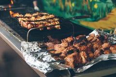 Grilled kebab cooking on metal skewer. Showcase of street food royalty free stock image