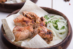 Grilled kebab meat. Grilled lamb meat with marinated onion in rustic style Stock Photo