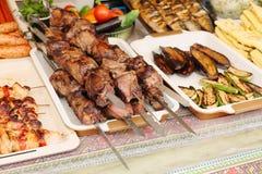 Grilled kebab on metal skewer. Showcase of street food stock images