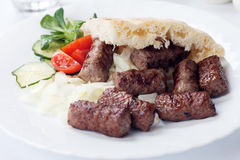 Grilled kebab with pita bread Stock Image