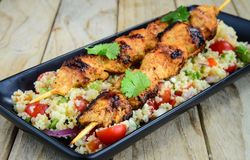 Grilled kebab served with couscous salad Stock Photos