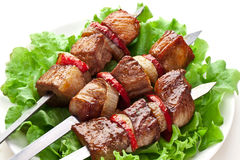 Grilled kebab (shashlik) on spits. Stock Image