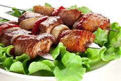 Grilled kebab (shashlik) on spits. Royalty Free Stock Photo